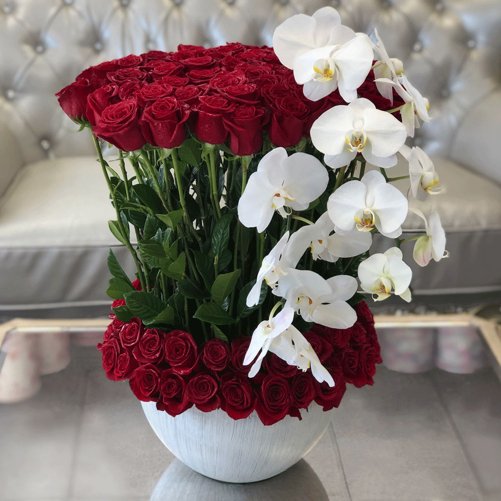 100 Roses & Orchids In A Vase